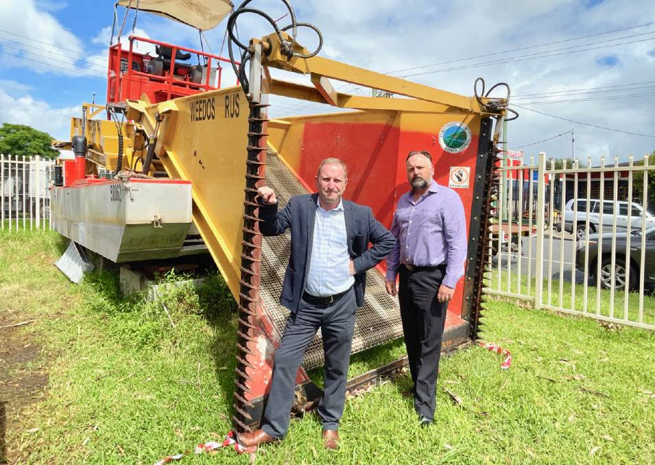 De-funded: HRCC Chairman, Clr Nathan Zamprogno, and General Manager Chris Dewhurst in front of the repaired, but de-funded 'Weedosaurus' weed harvester. Picture: Supplied.