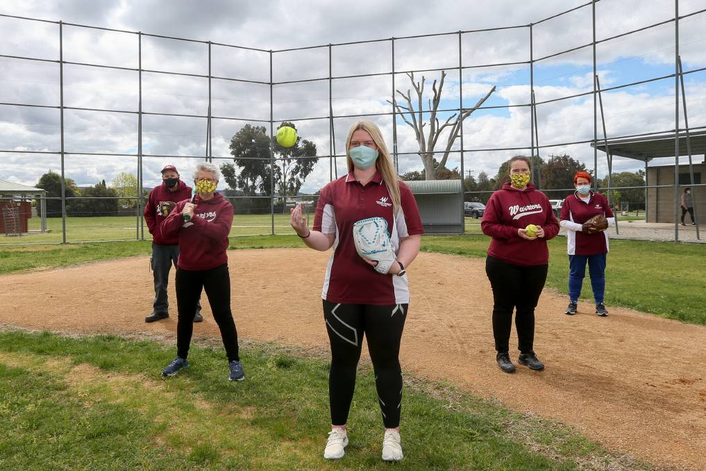 NO-GO ZONE: Keith Quinn (left), Tracey Chadwick, Joanna Garoni, Catherine Garoni and Liz Quinn are disappointed they can't play softball, due to COVID. The decision has stalled plans to recruit players. Picture: TARA TREWHELLA