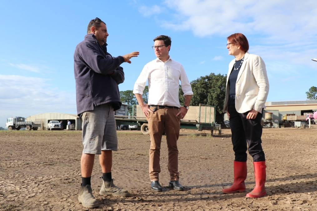 Recovery: Southern Cross Turf owner Paul Saad explains his situation to Emergency Management Minister David Littleproud and Macquarie MP Susan Templeman. Picture: Supplied