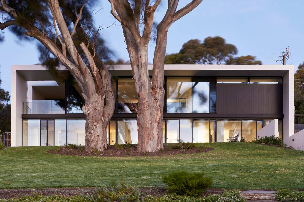 Nestled above the picturesque McLaren Vale wine region in South Australia, the award-winning Sugar Gum House designed by Architects Ink has a sculptural simplicity that embraces sustainable living. Pictures: Sam Noonan.