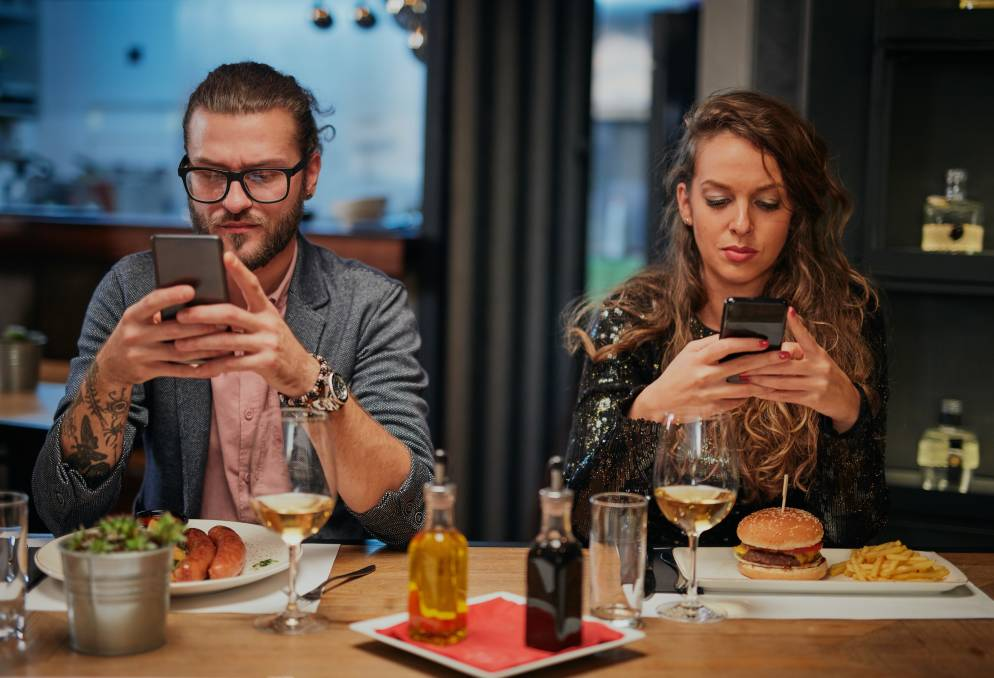 Some 64 per cent of iPhone users and 42 per cent of Android users use their phones at dinner.