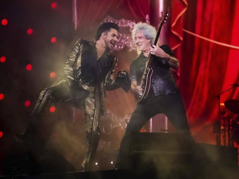 Adam Lambert (L) and Brian May of Queen are set to perform at the Fire Fight Australia concert.