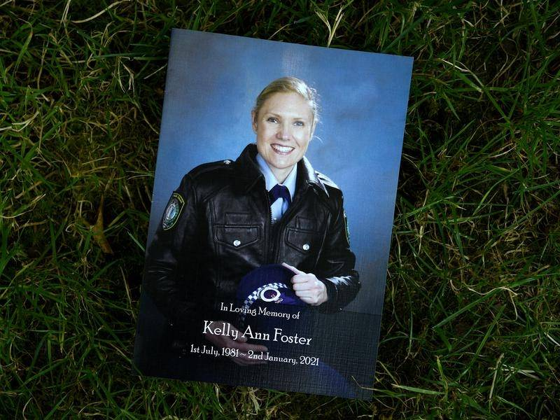 A funeral has been held for NSW police officer Kelly Foster, who drowned trying to save a canyoner.